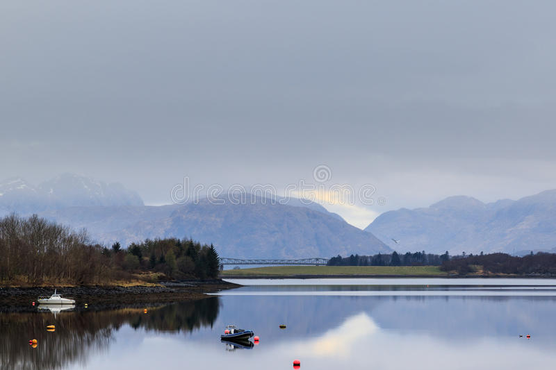 Scottish Loch on a misty day near glencoe. In Scotland stock photo