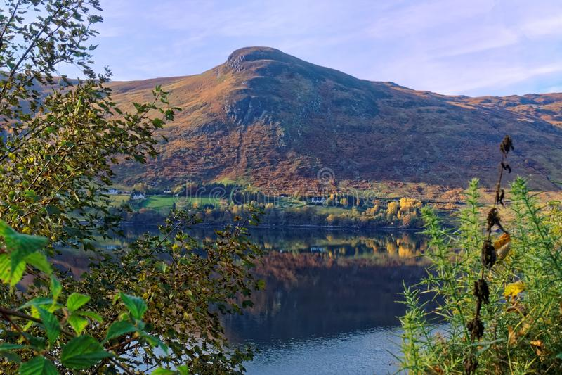 Scottish Loch and Mountain. A highland Scottish loch and mountain in autumn royalty free stock photography