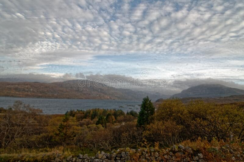 Scottish Loch-Side Under a Herring-Bone Sky royalty free stock photography