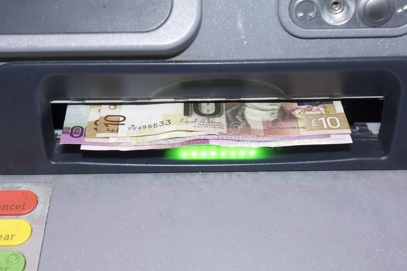 Scottish notes in a cash machine stock image