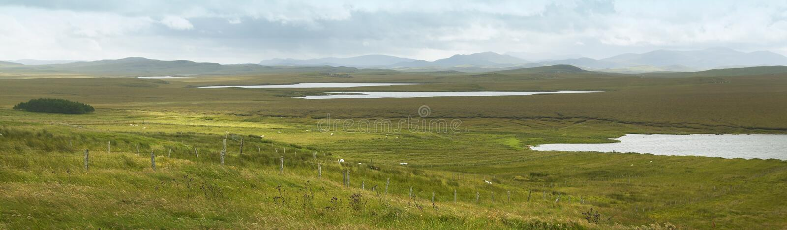 Scottish panoramic landscape with loch and moorland. Lewis isle. UK royalty free stock images