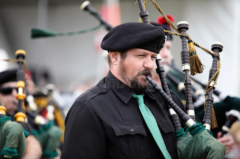 Scottish Piper in Band. Scottish piper playing in band in a parade at the 2013 Rio Grande Valley Celtic Festival in Albuquerque, New Mexico stock images