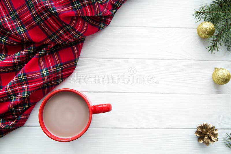 Scottish plaid, a red cup of hot cocoa with milk, golden decorations. Space for text. Free space. stock photos
