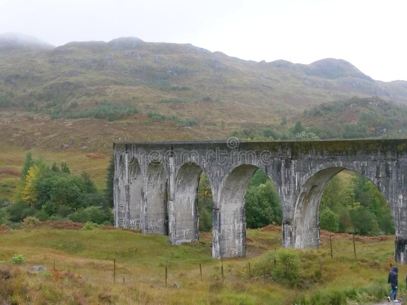 Scottish Railway Bridge Glenfinnan with mountains royalty free stock photography
