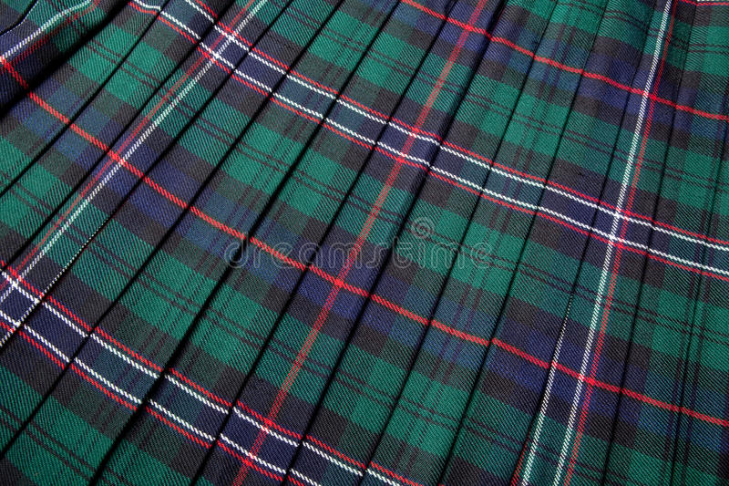 Scottish tartan. Pattern, part of a traditional kilt royalty free stock photo