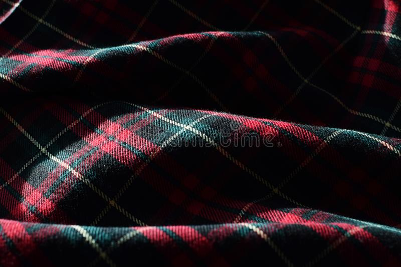 Scottish Tartan Material Fabric with Sunshine and Shadows highlighting Detail, Form and Texture stock photography