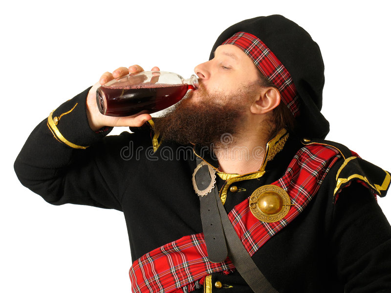 Scottish Warrior Drinking Wine Royalty Free Stock Image