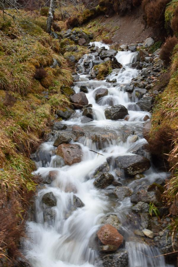 Scottish waterfall Water cascading over rocks royalty free stock images