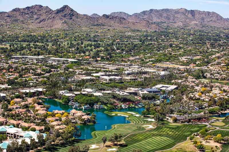 Scottsdale Skyline. Over Scottsdale, Arizona looking to the southwest at golf courses, resorts, luxury homes and Mummy Mountain royalty free stock image