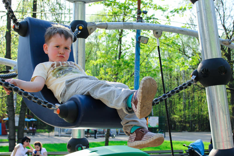 Scowl boy. Scowl little boy on the playground royalty free stock photography
