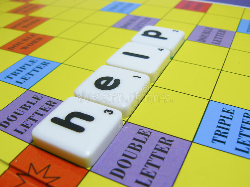 Scrabble Game Tiles - Help royalty free stock photography