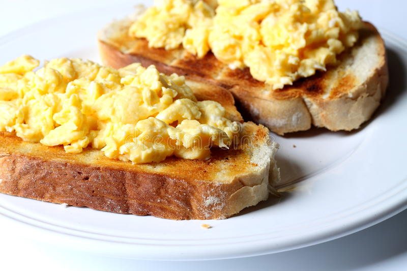 Scrambled egg on toast royalty free stock images