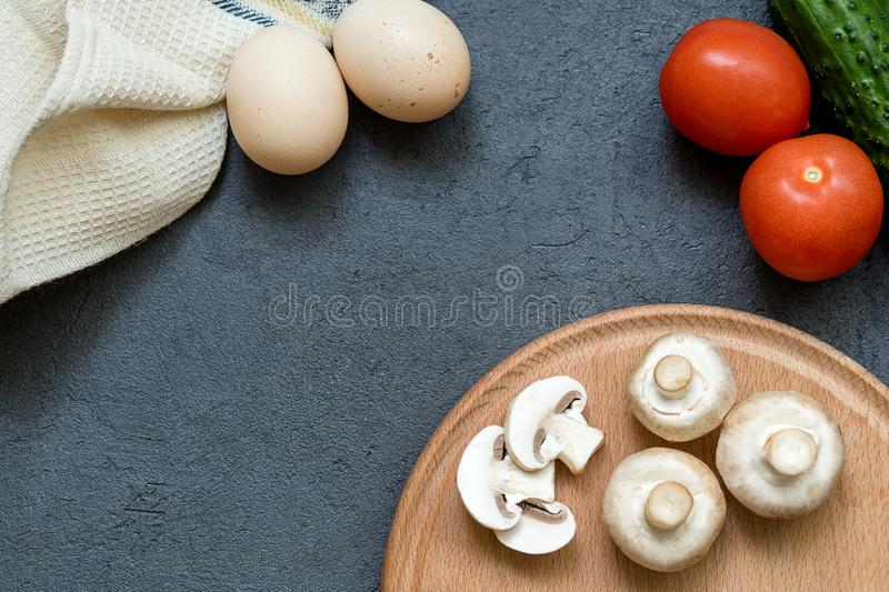 Scrambled eggs ingredients over grey stone table, above view, copy space royalty free stock image