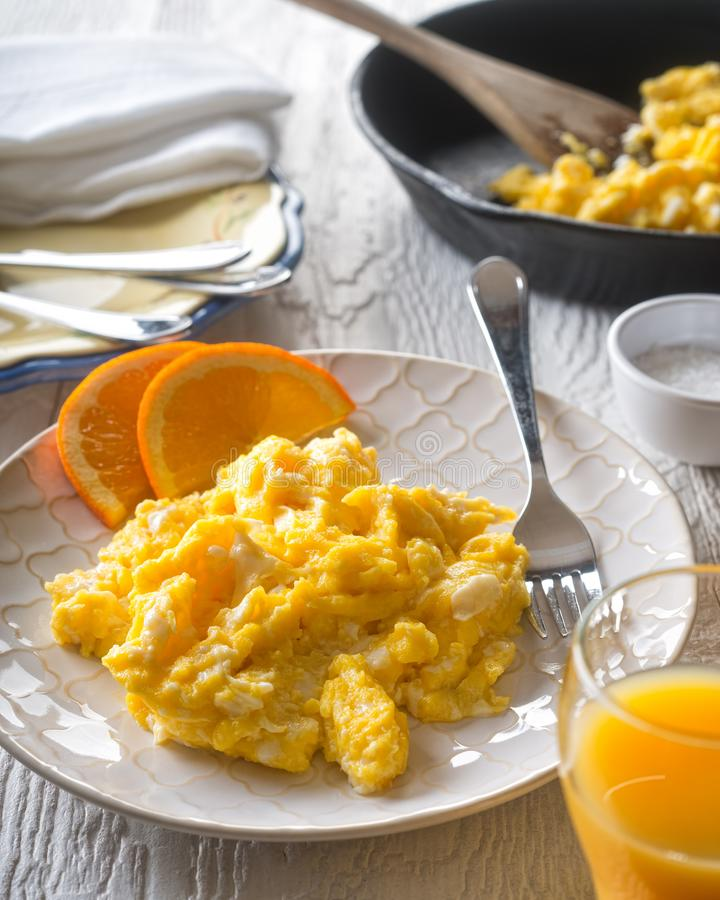 Download Scrambled Eggs With Orange Slices Stock Photo - Image of fried, meal: 107782628