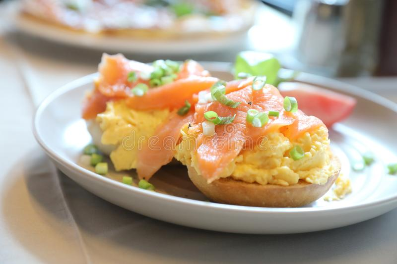 Scrambled eggs with smoked salmon on toast , Breakfast food. Scrambled eggs with smoked salmon on toast on a dish in close up , Breakfast food stock photography