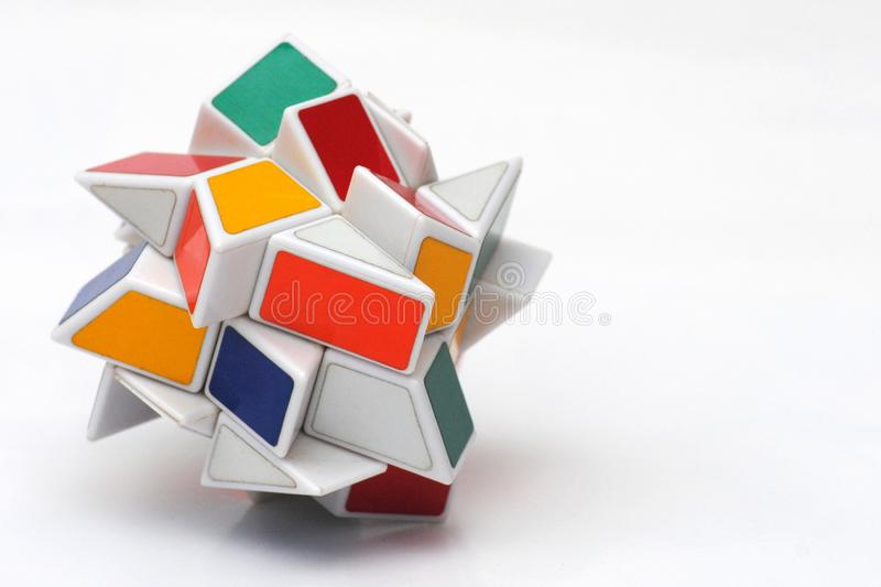 Scrambled Windmill Rubiks Cube. A windmill type Rubik cube scrambled isolated in white stock photography
