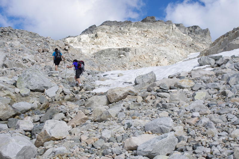 Scrambling hikers royalty free stock photos