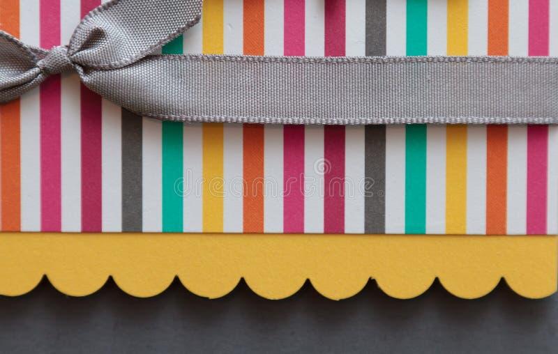 Scrap booking detail. Closeup of scrap booking paper and ribbon detail royalty free stock image