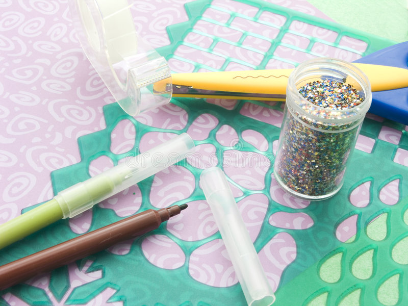 Scrap booking materials close up. With glitter royalty free stock image