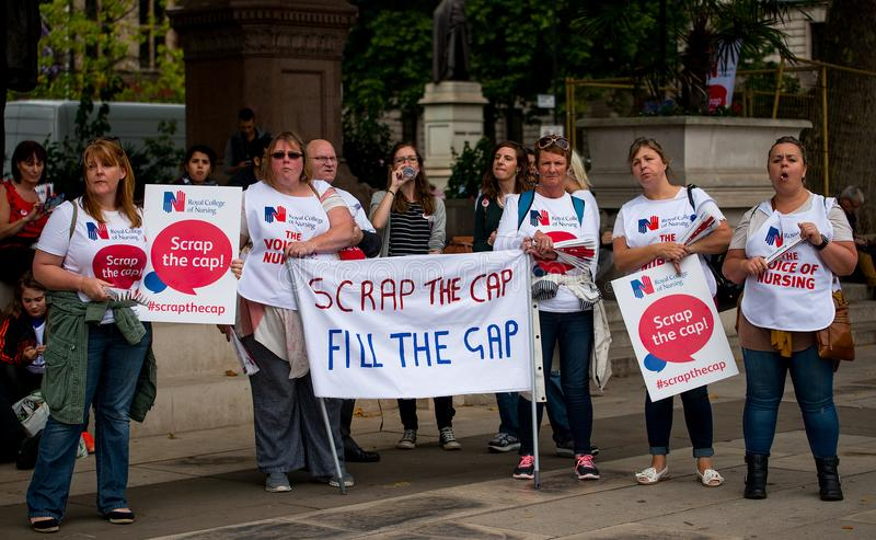 NHS - SCRAP THE CAP PROTEST. Scrap The Cap protest - Thousands of nurses gather at Parliament Square in London, UK, to campaign against the British government`s royalty free stock photography