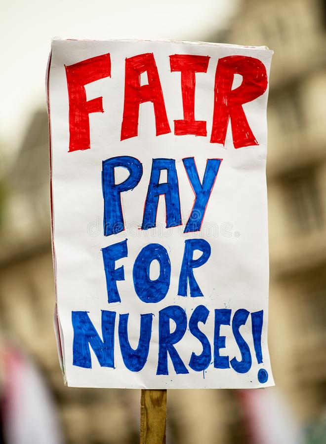 NHS - SCRAP THE CAP PROTEST. Scrap The Cap protest - Thousands of nurses gather at Parliament Square in London, UK, to campaign against the British government`s stock image