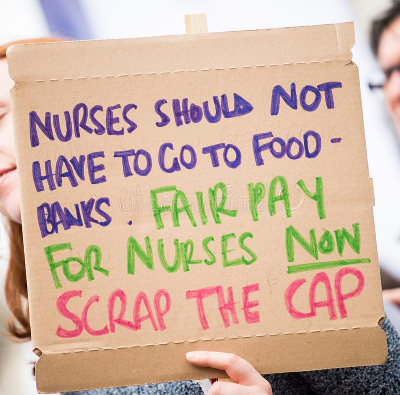 NHS - SCRAP THE CAP PROTEST royalty free stock image