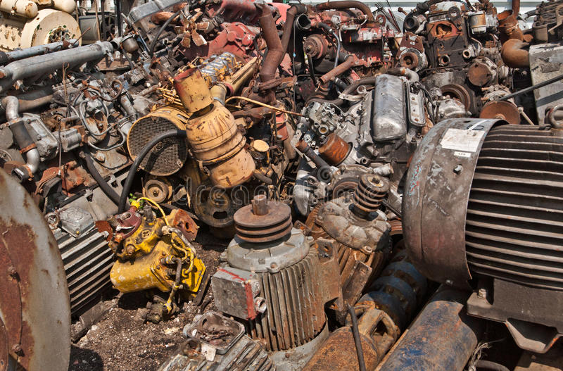 Scrap with electric motors on scrap-heap stock image