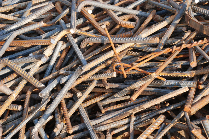 The scrap iron backgoround. The rusty scrap iron rod and steel bars with lines pile up in a construction site stock photography