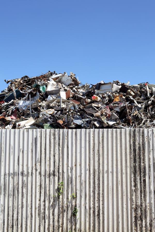 Scrap metal. Industrial scrap metal in wall royalty free stock photo