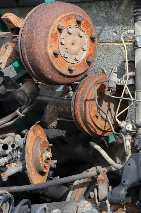 Scrap metal. A pile of rusting car parts and scrap metal in scrap yard including rear axles, suspension and brake parts royalty free stock photos