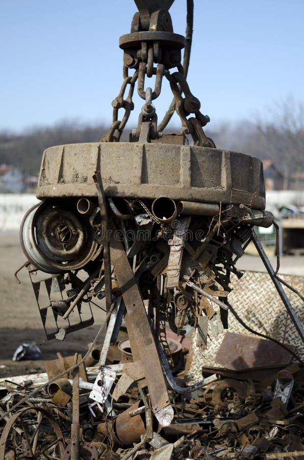 Scrap metal electro magnet. At scrapyard royalty free stock photos