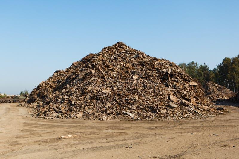 Scrap metal heap. On sky background royalty free stock photo