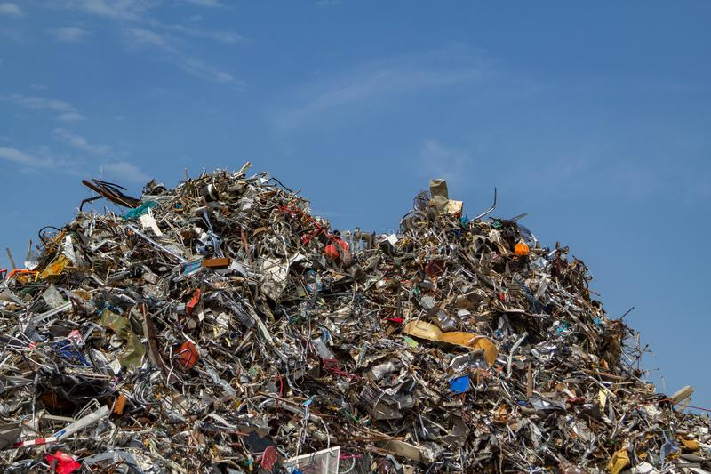 Scrap metal on a pile at a recycling junkyard. stock photo