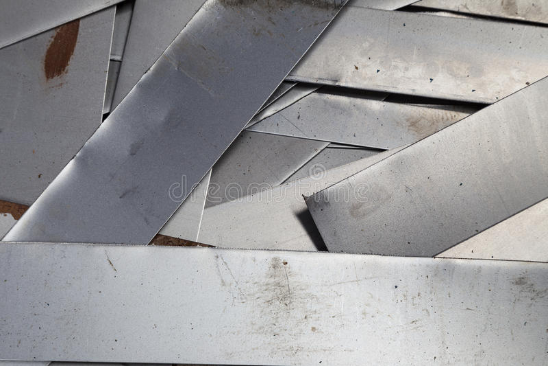 Scrap metal sheet. On floor royalty free stock images