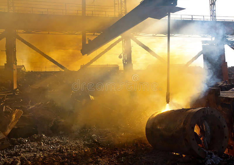 Scrap metal and smoke royalty free stock image