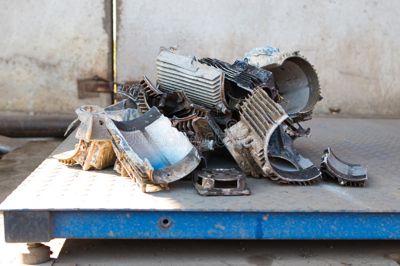 Scrap metal weighting. On digital scales royalty free stock photography
