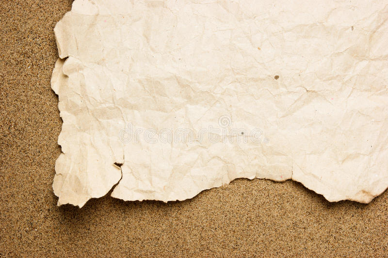 Scrap Of Old Torn Paper On Sandy Beach Royalty Free Stock Photo