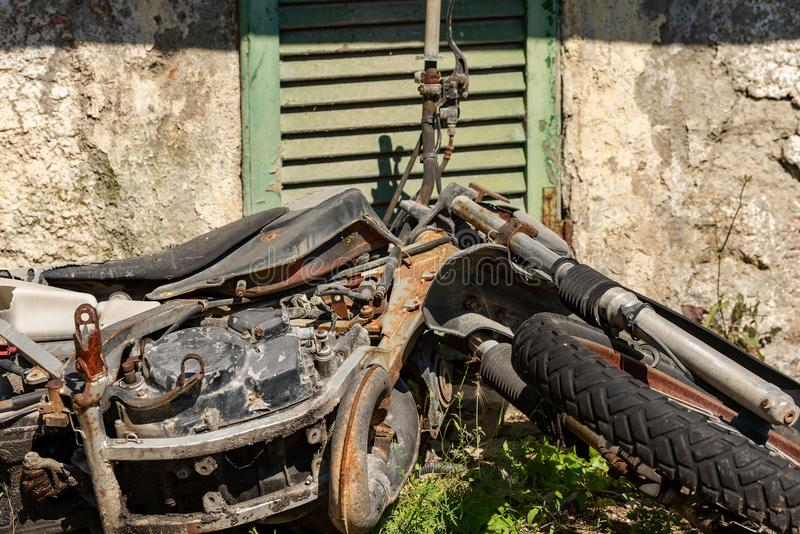 Scrap of a Rusty and Abandoned Motorbike royalty free stock image
