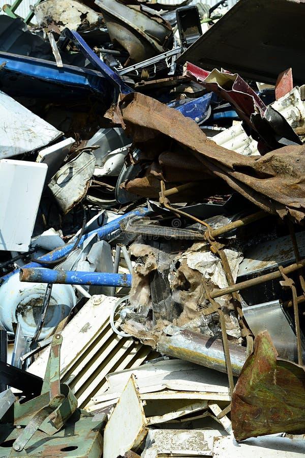 Scrap yard, scrap metal on waste dump in a recycling company. Scrap yard, scrap metal and iron on waste dump in a recycling company royalty free stock photos