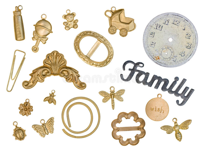 Scrapbook Gold Charms. Scrapbook Multiple Gold Charms Isolated on White royalty free stock photography