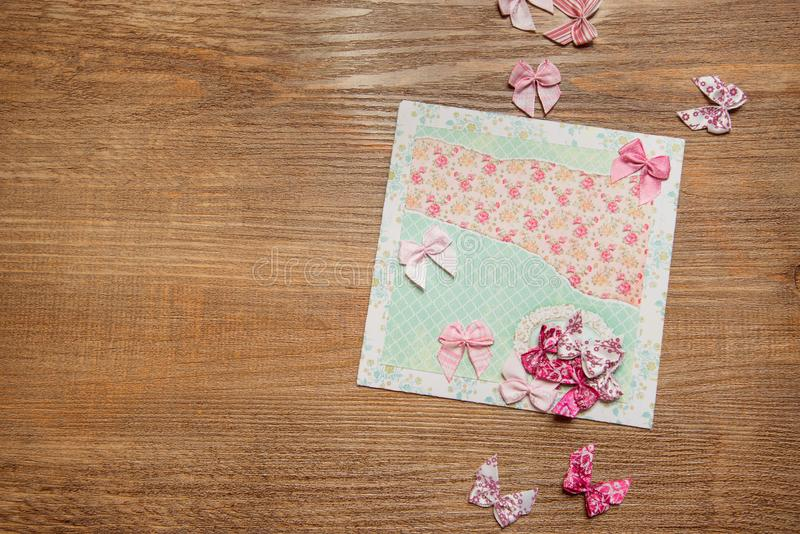 Scrapbooking elements and homemade greeting card on wooden background, top view with copy space.  stock photos