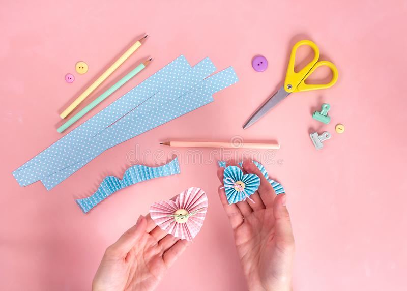 Scrapbooking master class. Diy. Make a Valentines day card whith paper hearts. Women& x27;s hobby. Craft supplies on the table. royalty free stock image