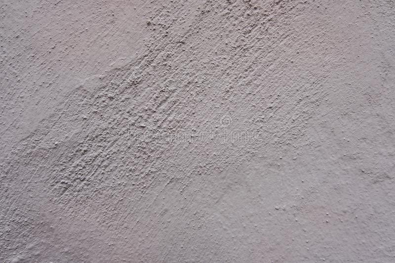 Scraped white concrete wall background. Texture of a wall in the city. World. Perfect wallpaper background. No people royalty free stock image