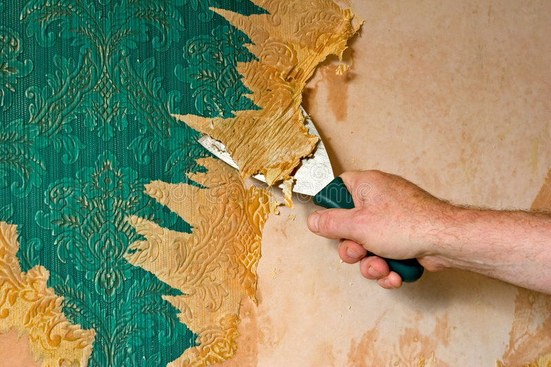 Scraping off wallpaper. Scraping off old vintage wallpaper royalty free stock images