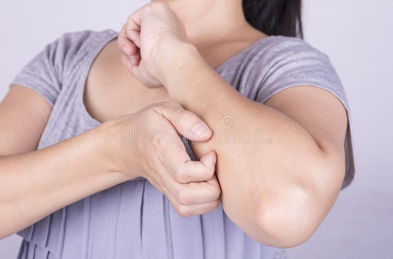 Scratch the itch. Women scratch the itch with hand. Concept photo with Healthcare And Medicine royalty free stock photos