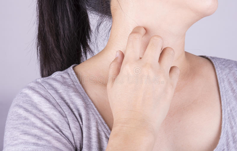 Scratch the itch. Women scratch the itch with hand. Concept photo with Healthcare And Medicine stock image