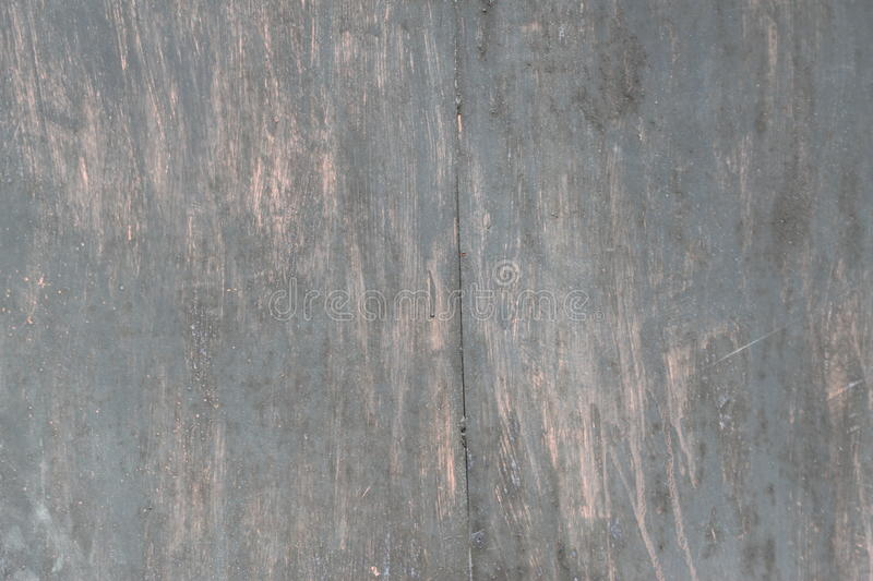 Scratched black metal surface. Black scratched metal surface with peeling paint stock photo