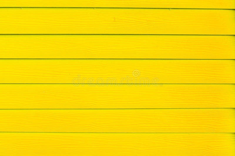 Scratched and dirty wood painted yellow Wood plank texture backg stock photo