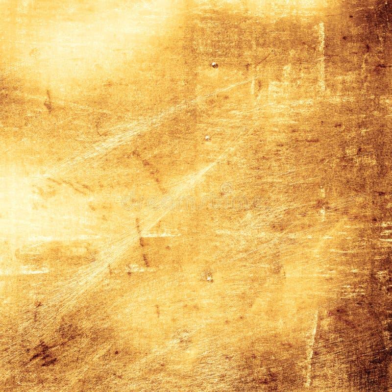 Scratched gold metal background. Grunge scratched gold metal background stock images