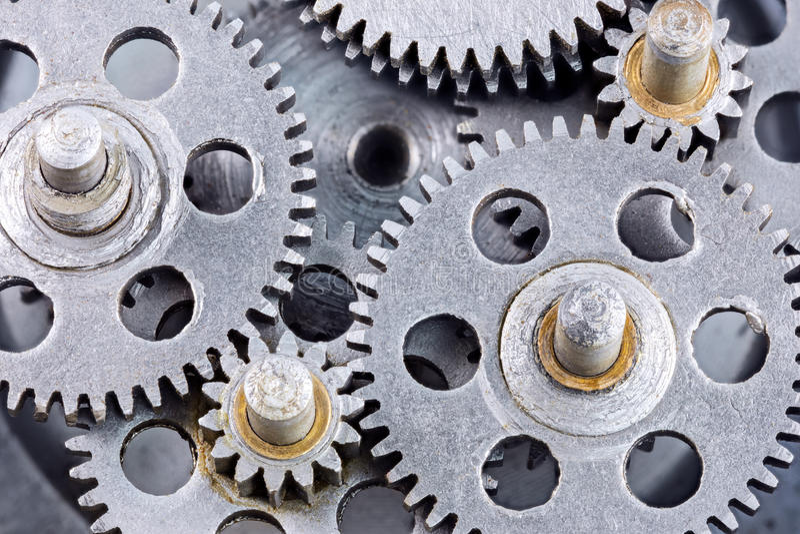 Scratched industrial metal gear cogwheels closeup. Scratched industrial metal gear cogwheels macro view stock photos